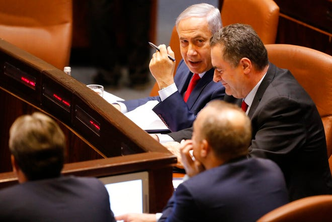 Israeli Prime Minister Benjamin Netanyahu before voting in the Knesset, Israel's parliament in Jerusalem, Wednesday, May 29, 2019. Netanyahu faced a deadline at midnight Wednesday to form a new governing coalition as he tried to stave off a crisis that could trigger an unprecedented second election this year or even force the longtime leader to step down.