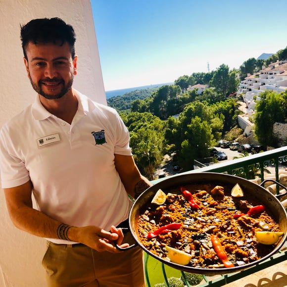 Invented in Valencia, the rice-based dish called paella is the Spanish national dish, served here on the terrace at Altea Golf Club.