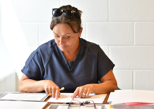 Inmate Hope Zentz proofreads her manuscript, before sending it to the Library of Congress. She would get a score of 91 on it.