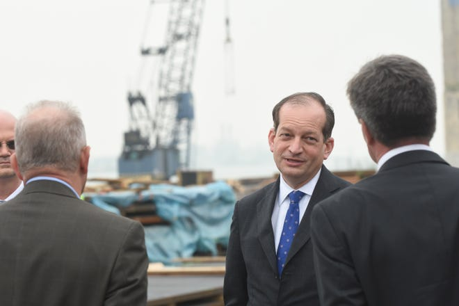 U.S. Secretary of Labor Alexander Acosta  (center) tours the Port of Detroit Nicholson Terminal on the Detroit River on Wednesday, May 29, 2019.