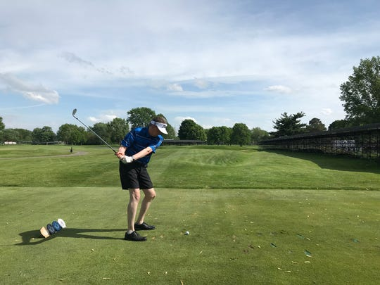 Detroit News assistant sports editor Mark Falkner hits his tee shot at the 15th, and would you believe he actually found the green? We couldn't believe it either, but it happened!