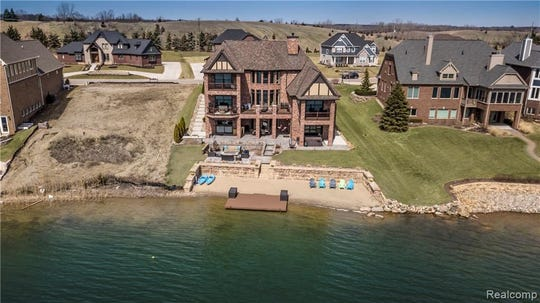 """The custom features inside and out were all hand picked, plus (the house has) a premium view of the gorgeous waterfall and crystal clear spring-fed lake. Hidden Lake is truly a one of a kind community,"" said Realtor Terri Fenelon of KW Realty Livingston."