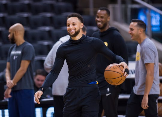 Golden State Warriors guard Stephen Curry smiles during practice for the NBA Finals against the Toronto Raptors on Wednesday.