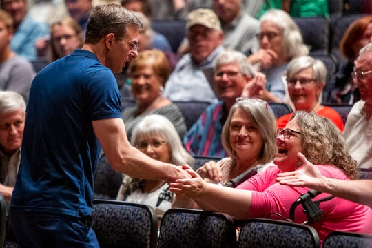 U.S. Rep. Justin Amash, R-Cascade Township, greets the crowd before holding a town hall meeting at Grand Rapids Christian High School's DeVos Center for Arts and Worship on Tuesday, May 28, 2019. The congressman came under scrutiny May 18 when he posted a series of Tweets to outline his support for impeachment proceedings. As such, he is the only Republican congress member to do so. The following days brought an announcement from the wealthy DeVos family about no longer supporting him financially.