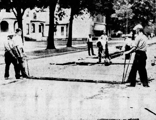 Workers pave Lake Street in 1939 after trolley tracks were removed.