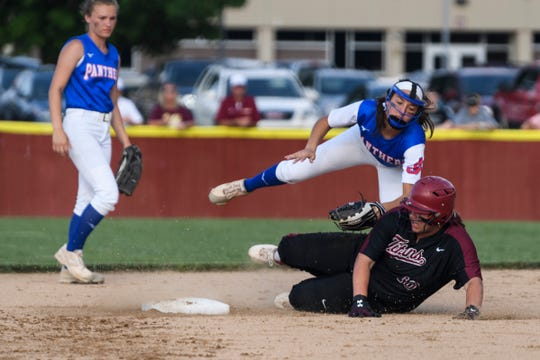 Gibson Southern's Lauren Lingafelter (16) slides into second base as Jennings County's Kylee Matern tags her out during the second inning of the IHSAA Class 4A softball regional at Gibson Southern High School in Fort Branch, Ind., Tuesday, May 28, 2019. The Titans defeated the Panthers, 6-1, to advance to semi-states.