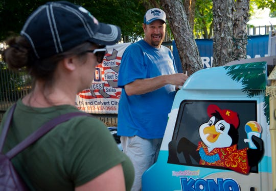 Brian Smith, a Bend Gate Elementary School teacher, serves up Kona Ice 40 hours each week for a summer job to help supplement his family's income. Smith works 15-25 hours each week for part of the school year.