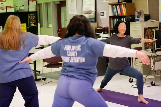 Yoga instructor Lora Vahlsing works with two female inmates Wednesday, May 29, 2019 at the juvenile detention center at the Fond du Lac County jail in Fond du lac, Wis. Doug Raflik/USA TODAY NETWORK-Wisconsin
