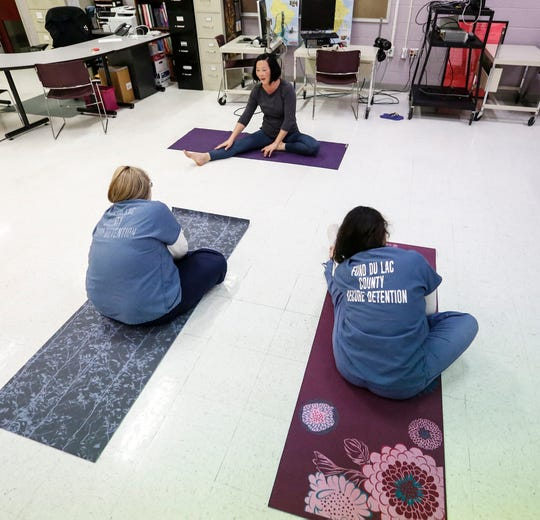 Yoga instructor Lora Vahlsing is one of dozens of volunteers who reach out to juveniles in the detention center at Fond du Lac County Jail. She says yoga helps youth learn self control. Wednesday, May 29, 2019 in Fond du lac, Wis. Doug Raflik/USA TODAY NETWORK-Wisconsin