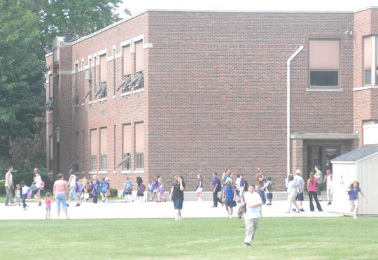 Lutz Elementary School, shown here in a file photo, is being replaced by a new building that is now under construction. The City of Fremont will begin installing a new water line for the school project starting Monday.