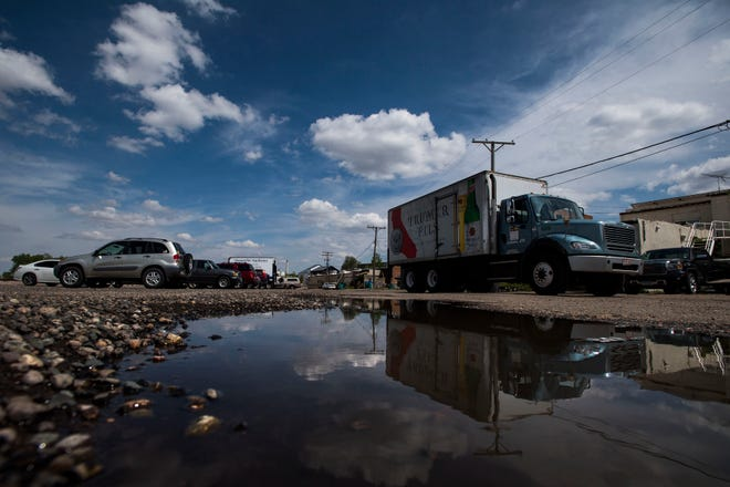 A beer delivery truck pulls away from the parking lot after a delivery to Chimney Park Restaurant & Bar on Wednesday, May 29, 2019, behind Main Street in Windsor, Colo.