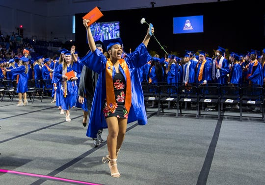 Victoria Guzman, 17, cheers with excitement after receiving her diploma during Cape Coral High School's graduation ceremony Saturday afternoon, May 18, 2019, at Suncoast Credit Union Arena. About 360 graduates accepted their diplomas.