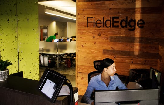 Julissa Acosta works as an office manager at the FieldEdge offices in downtown Fort Myers on Wednesday May, 29, 2019. The office was the former McCrory's.