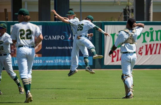 Melbourne Central Catholic teammates jump for joy as they celebrate their victory Wednesday morning, May 29, 2019. MCC faced off against Swannee High School in a Class 5A state baseball semifinal game. The MCC Hustlers defeated the Bulldogs by a score of 2-0.