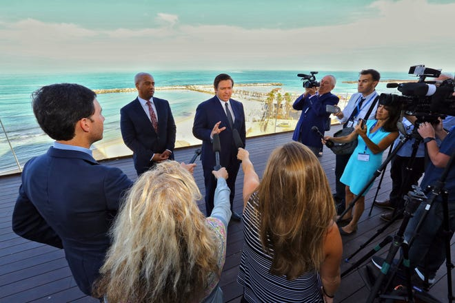 With the Mediterranean Sea as a backdrop, Florida Gov. Ron DeSantis speaks to reporters Monday, May 27, 2019, ahead of the first full day of a Florida trade delegation trip to Israel. DeSantis is leading a delegation on a four-day trade mission to help boost the state's economy and solidify its bonds with Israel.