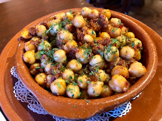 Fried chickpeas are speckled with Serrano ham and chorizo at Barbosa Kitchen in Naples.