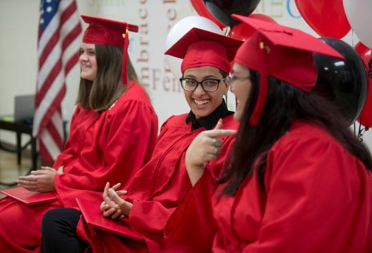 PACE Center for Girls graduates Olivia Condon, left, Helen Gomez and Crystel Reyes-Pedrozo, right, laugh after turning their tassels at their graduation on Wednesday, May 29, 2019, in Fort Myers.