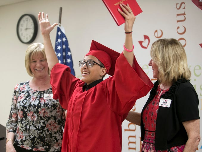 Helen Gomez celebrates after receiving her diploma at her graduation from PACE Center for Girls on Wednesday, May 29, 2019, in Fort Myers.