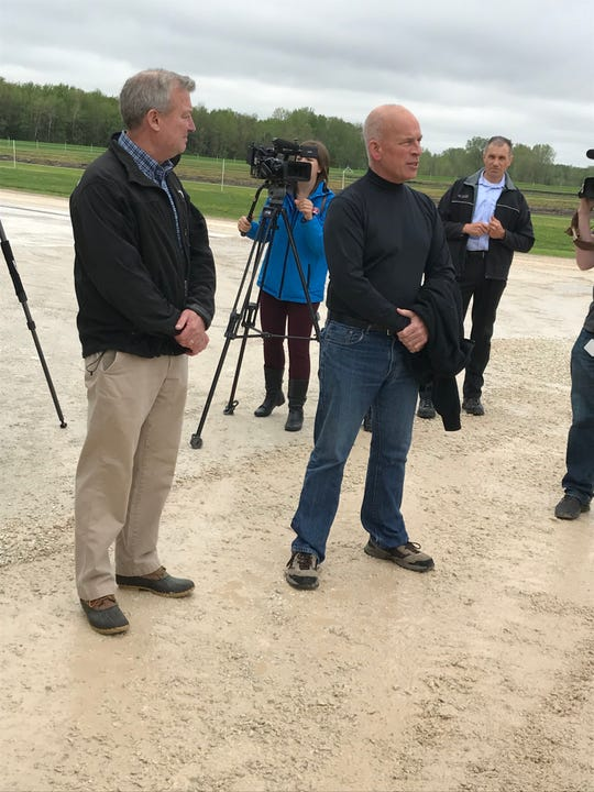 Peninsula Pride Farms President Don Niles gives opening remarks Tuesday, May 28, 2019, before a tour with Gov. Tony Evers and state Rep. Joel Kitchens, left, of Deer Run Dairy in Kewaunee.