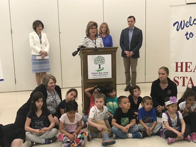 Diane Root (center) spoke about how the Head Start program has positively impacted her granddaughters during a news conference Wednesday at the Head Start Learning Center in Green Bay. The Green Bay School District announced Wednesday it would be expanding the number of all-day Head Start spots available to students. Also in attendance were Superintendent Michelle Langenfeld (back left); Sally Jansen, head start director and principal of Head Start Learning Center, and U.S. Rep. Mike Gallagher. Head Start students and staff turned out to listen to the announcement.