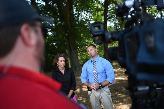 Greenville County Schools spokesperson Elizabeth Brotherton and Lt. Ryan Flood of the Greenville County Sheriff's Office address the media at Berea High School on Wednesday, May 29, 2019, after a student reportedly brought a BB Gun to school.