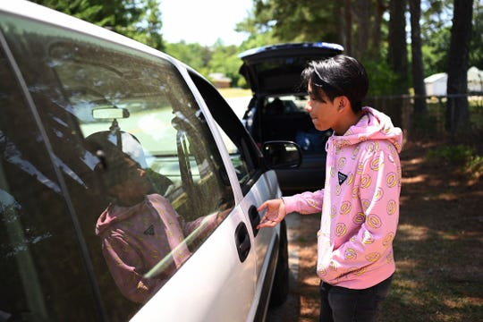 Jorge Olivos, 16, a Berea High School freshman gets into his car ride on Wednesday, May 29, 2019