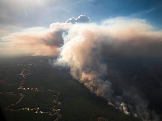 Alberta Premier Jason Kenney joined officials on an aerial tour of the fire-affected area in northern Alberta and met with first responders and staff at the emergency operations center in High Level, where a massive fire is burning.