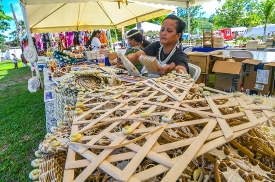 Shell nautical maps and other wares made by artisans from the Marshall Islands are displayed for sale to visitors during the first day of the Guam Micronesia Island Fair at the Plaza de Espana in Hagåtña on Wednesday, May 29, 2019.