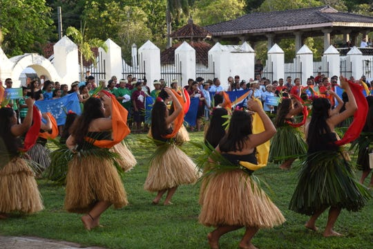 Guma' Ininan I Saina-ta cultural group members perform during the opening ceremony of the Guam Micronesia Island Fair held at Plaza de España on May 29, 2019.