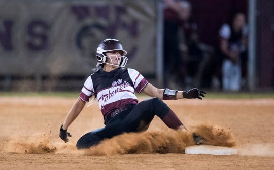 Henderson County's Kaytlan Kemp (1) slides into second during the Second Region Softball semifinal game against the Madisonville Maroons  Tuesday, May 28, 2019.