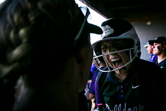 Brownsburg infielder, Anna Carroll, (2), yells in the dugout with a teammate in the final innings against Decatur Central during the IHSAA Regional Softball Championships at Brownsburg High School, Brownsburg, IN. on Tuesday, May 28, 2019. Brownsburg defeated Decatur Central, 1-0 in 7 innings.