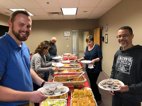 Indesign employees are shown enjoying  the Top Workplaces 2019 company's annual SouperBowl cookoff.
