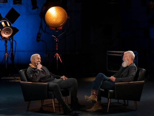 "Kanye West, left, chats with David Letterman during an episode of Letterman's Netflix series ""My Next Guest Needs No Introduction."""