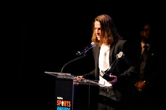 Cole Hocker of Cathedral accepts the award for top boys cross country runner during the IndyStar Sports Awards at Clowes Hall on the campus of Butler University,, May 5, 2019.