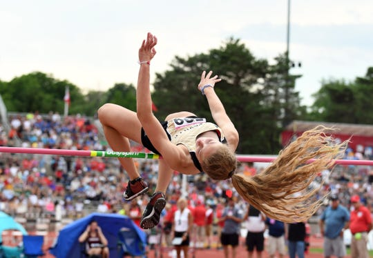 Noblesville's Shelby Tyler competes in the high jump during the girls IHSAA track and field state finals at Robert C. Haugh Track and Field complex in Bloomington, Ind. on Friday, May, 1, 2018.