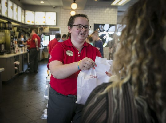 Chick-Fil-A employee, Ally Goble, delivers to a customer, May 16, 2019, at the Noblesville store off of Bergen Blvd.