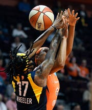 Connecticut Sun guard Jasmine Thomas loses the ball as Indiana Fever guard Erica Wheeler defends in a WNBA basketball game, Tuesday, May 28, 2019, in Uncasville, Conn.