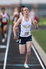 Cathedral senior Cole Hocker finishes the 800 meters in first place at IHSAA boys track and field sectionals, May 17, 2019.