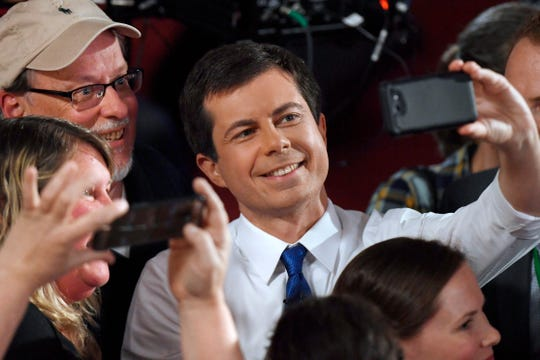 Democratic presidential candidate South Bend Mayor Pete Buttigieg takes a selfie with audience members after a Fox News Channel town hall on Sunday, May 19, 2019, in Claremont, N.H.