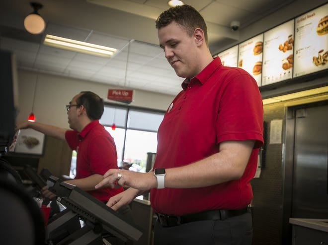 Chick-Fil-A employee, Mackenzie Rhyno, takes orders from a customer Chick-Fil-A, May 16, 2019, at the Noblesville locations off of Bergen Blvd. Chick-fil-A is one of Central Indiana's Top Workplaces for 2019.