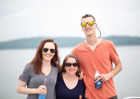 From left, Creative Manager Maggie Tharp, Customer Success Manager Jen Capenito, and Steven Watkins, marketing automation specialist, enjoy a team bonding day for FormAssembly employees at Monroe Lake in Bloomington, Ind.