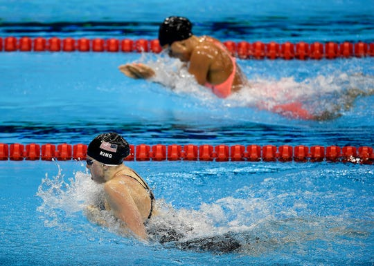 United States' gold medal winner Lilly King, front, and Russia's silver medal winner Yulia Efimova compete in the women's 100-meter breaststroke final during the swimming competitions at the 2016 Summer Olympics, Aug. 8, 2016, in Rio de Janeiro, Brazil.