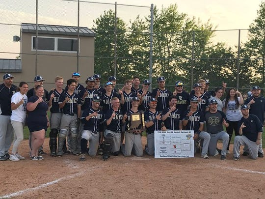 Decatur Central players, coaches and team managers pose after claiming the Sectional 11 championship on Tuesday night.