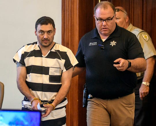 Oxford Police Officer Matthew Kinne, center, is escorted into a hearing by Lafayette County Sheriff Dept. Maj. Alan Wilburn at the Lafayette County Courthouse, Wednesday, May 22, 2019, in Oxford, Miss. Kinne is charged in the death of 32-year-old Dominique Clayton, who was found dead Sunday.