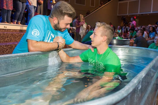 Pastor Brandon Blair baptizes Zachary Munday at Fairview Baptist Church in Corryton on August 22, 2018.