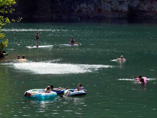 Swimmers and paddleboarders enjoy Mead's Quarry on Sunday, May 26, 2019.