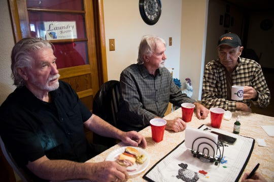 From left, brothers Mike, Ron and Doug Bledsoe sit at Doug's kitchen table, northwest of Knoxville, Tuesday, March 5, 2019. All three worked on the Kingston coal ash spill and have experienced health issues since then.