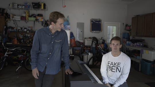 """Filmmaker Luke Menard, left, used his brother as a stand-in for singer-songwriter Ben Rector for a series of 2018 videos that pitched the musician the idea of taking Menard on the road for a documentary about his tour. Rector bought the idea. The result, """"Magic: The Tour,"""" a short film by Menard came out May 13, 2019."""