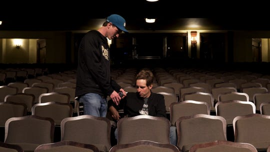 """Luke Menard, a filmmaker and Purdue student, arranges a microphone for singer-songwriter Ben Rector for an interview for """"Magic: The Tour,"""" a short documentary released May 13."""