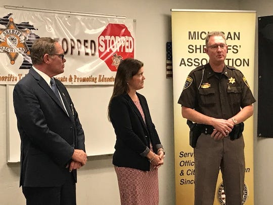 Michigan Sheriff Association CEO Blaine Koops and State Farm agent Katie Pikkarainen listen to Livingston County Sheriff Michael Murphy explain the STOPPED program on Wednesday, May 29, 2019.